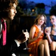 Stock Photo: Flirtatious young girls staring at handsome guy