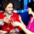 Stock Photo: Cheers! Couple celebrating their love together