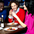 Friends enjoying dinner at restaurant — Stock Photo