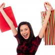 Joyous young girl enjoying her shopping — Stock Photo