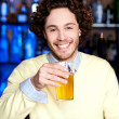 Young guy having chilled beer at bar — Stock Photo