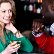 Young couple having conversation in bar — Stock Photo