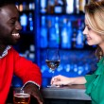 Young couple at bar — Stock Photo