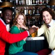 Three friends in bar enjoying beer — Stock Photo