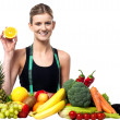 The beautiful girl with fruits and vegetables — ストック写真