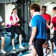 Couple with personal fitness trainer in the gym — Stock Photo #25308363