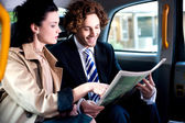 Corporates discussing finances published in newspaper — Stock Photo