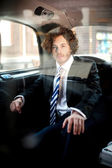Handsome business corporate inside taxi cab — Stock Photo