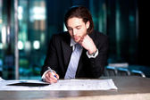 Smart businessman projecting his plans — Stock Photo