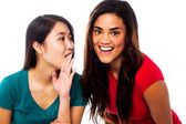 Two young girls gossiping — Stock Photo