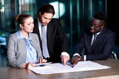 Business team of three reviewing project plan — Stock Photo