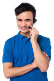 Happy young customer support executive — Stock Photo