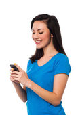 Pretty girl sending text message to her boyfriend — Stock Photo
