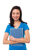 Young girl holding notebook — Stock Photo