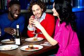Friends enjoying dinner at restaurant — Stock Photo