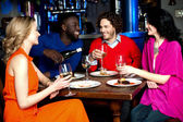 Young couples enjoying their dinner with drinks — Stock Photo