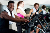 Gym trainer exercising along with his trainees — Stock Photo
