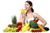 Healthy caucasian girl eating banana — Stock Photo