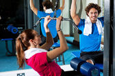 Man and woman in a fitness club — Stock Photo