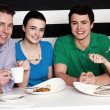 Happy family of four at restaurant — Stock Photo