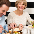 Couple enjoying breakfast in restaurant - Stock Photo