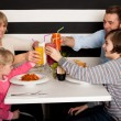 Stock Photo: Family toasting smoothies in restaurant