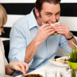 Handsome male enjoying his delicious sandwich — Stock Photo