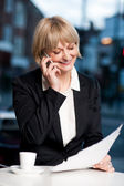 Manager communicating via cell phone in cafe — Stock Photo