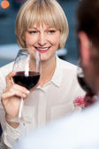 Couple sipping red wine and cherishing memories — Stock Photo