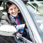 Successful businessman driving a luxurious car — Stock Photo #27648619