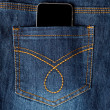 Cellphone in jeans pocket — Stock Photo