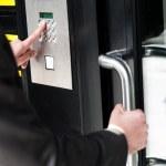 Man entering security code to unlock the door — Stock Photo