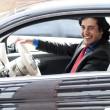 Corporate man driving his car — Stock Photo