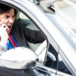 Angry businessman shouting while driving — Stock Photo