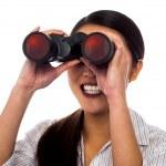 Corporate woman viewing through binoculars — Stock Photo #27649161