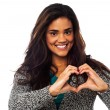 Pretty woman making heart symbol with hands — Stock Photo