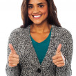 Attractive girl showing double thumbs up — Stock Photo