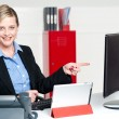 Female executive pointing at computer screen — Stock Photo