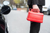 Man holding fuel can, cropped image — Stock Photo