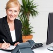 Business executive writing her appointments — Stock Photo