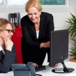 Two cheerful corporate women in office — Stock Photo
