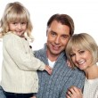 Portrait of a happy family indoors — Stock Photo