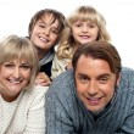 A happy family on white background — Stock Photo