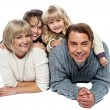 Stock Photo: Joyful family of four, studio shot