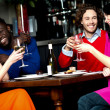 Friends enjoying dinner at a restaurant — Stock Photo #27651585