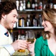 Stock Photo: Couples enjoying drinks in nightclub