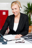 Female assistant communicating with client — Stock Photo