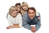 Joyful family of four, studio shot — Stock Photo