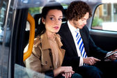Business on the way to attend conference — Stock Photo