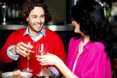 Cheers! Couple celebrating their love together — Foto de Stock